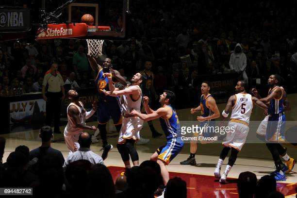 Draymond Green of the Golden State Warriors drives to the basket against Kevin Love of the Cleveland Cavaliers in Game Four of the 2017 NBA Finals on...