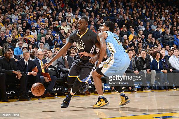 Draymond Green of the Golden State Warriors drives to the basket during the game against the Denver Nuggets on January 2 2016 at ORACLE Arena in...