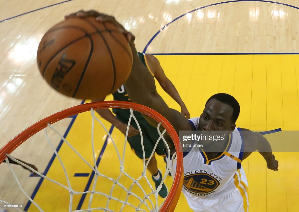 Draymond Green #23 of the Golden State Warriors dunks against Boris Diaw #33 of the Utah Jazz during Game One of the NBA Western Conference Semi-Finals at ORACLE Arena on May 2, 2017 in Oakland, California.