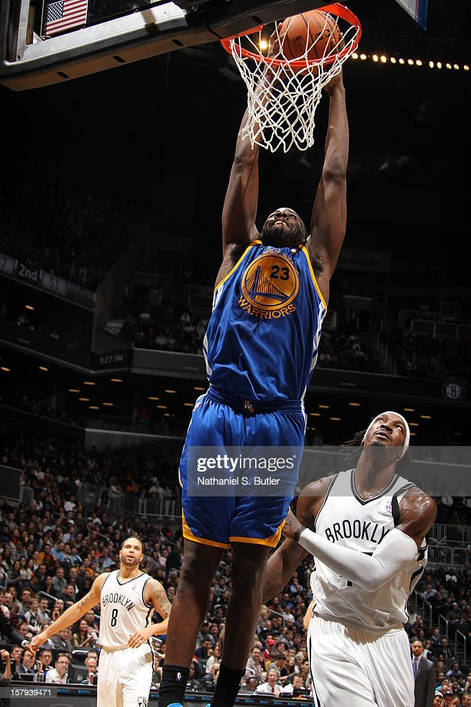 <a gi-track='captionPersonalityLinkClicked' href=/galleries/search?phrase=Draymond+Green&family=editorial&specificpeople=5628054 ng-click='$event.stopPropagation()'>Draymond Green</a> #23 of the Golden State Warriors dunks against the Brooklyn Nets on December 7, 2012 at the Barclays Center in the Brooklyn Borough of New York City.
