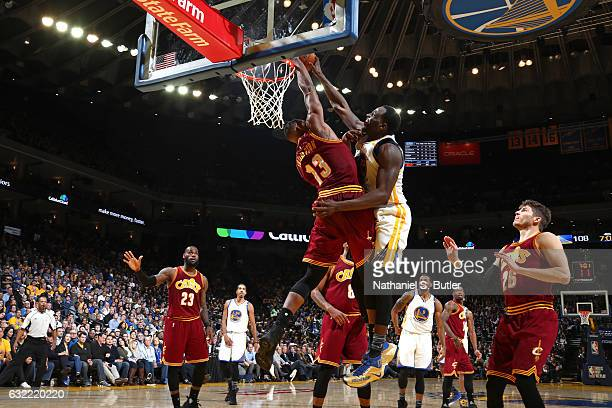 Draymond Green of the Golden State Warriors dunks against Tristan Thompson of the Cleveland Cavaliers on January 16 2017 at ORACLE Arena in Oakland...