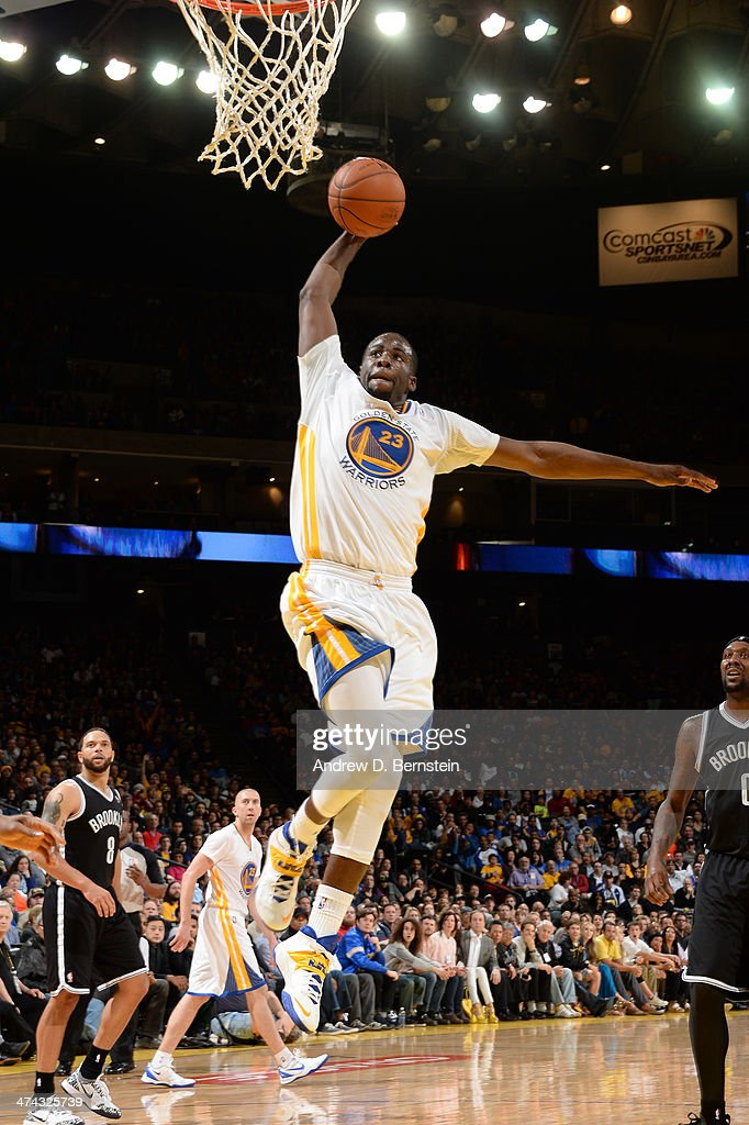 <a gi-track='captionPersonalityLinkClicked' href=/galleries/search?phrase=Draymond+Green&family=editorial&specificpeople=5628054 ng-click='$event.stopPropagation()'>Draymond Green</a> #23 of the Golden State Warriors dunks during a game against the Brooklyn Nets at Oracle Arena on February 22, 2014 in Oakland, California.