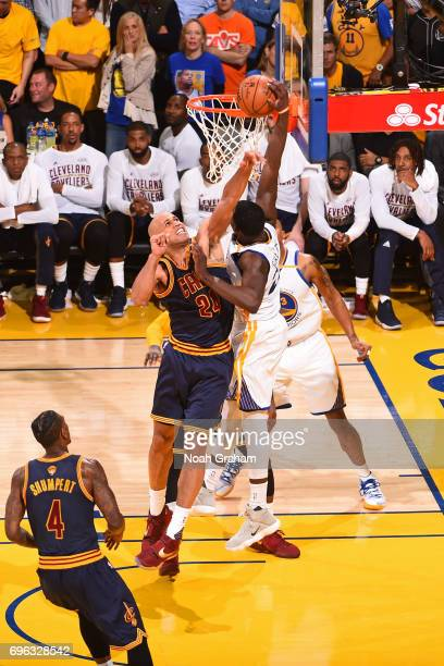 Draymond Green of the Golden State Warriors dunks the ball while defended by Richard Jefferson of the Cleveland Cavaliers in Game One of the 2017 NBA...