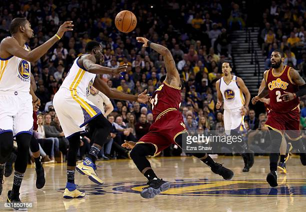 Draymond Green of the Golden State Warriors fouls LeBron James of the Cleveland Cavaliers at ORACLE Arena on January 16 2017 in Oakland California...