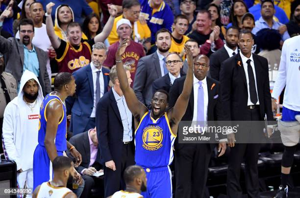 Draymond Green of the Golden State Warriors gestures to the crowd after a technical foul in the third quarter against the Cleveland Cavaliers in Game...