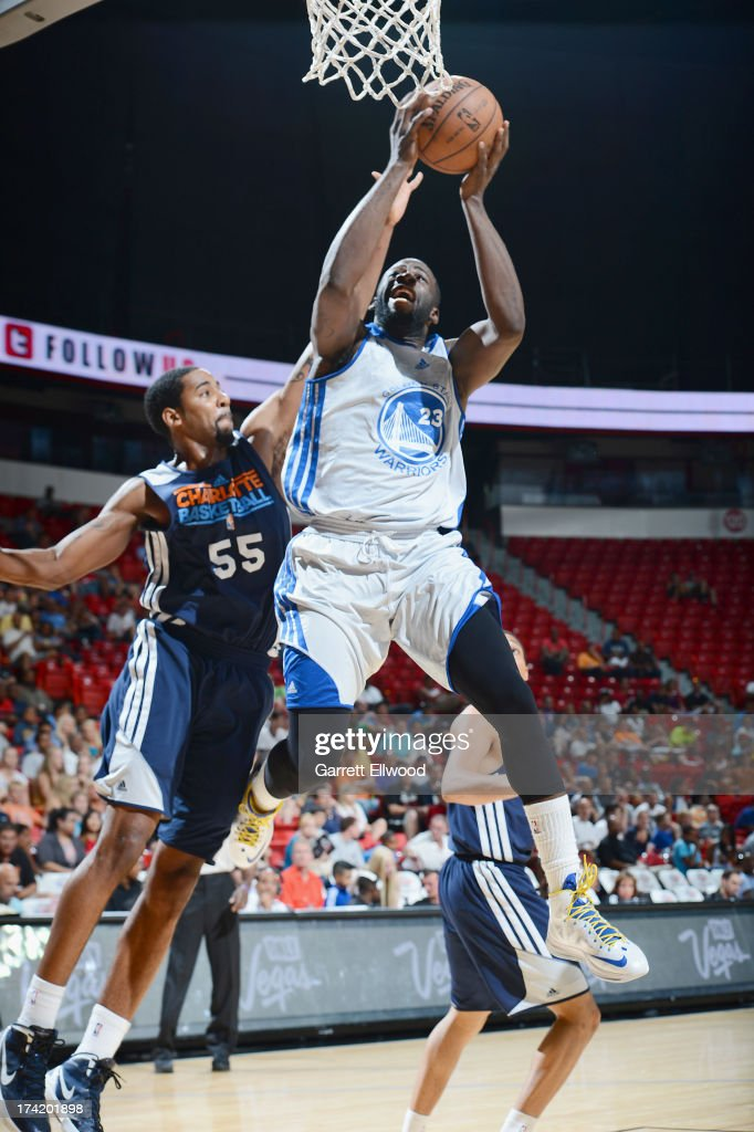 Draymond Green #23 of the Golden State Warriors goes to the basket against Keith Benson #55 of the Charlotte Bobcats during NBA Summer League game between the Charlotte Bobcats and the Golden State Warriors on July 21, 2013 at the Cox Pavilion in Las Vegas, Nevada.