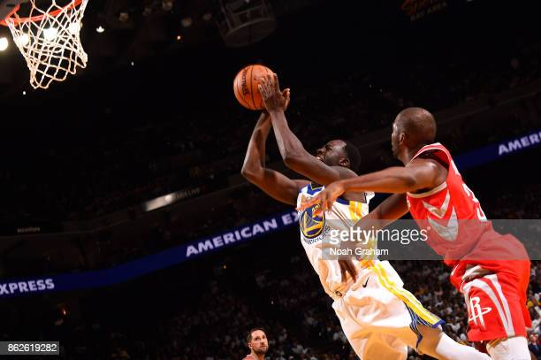 Draymond Green of the Golden State Warriors goes to the basket against the Houston Rockets on October 17 2017 at ORACLE Arena in Oakland California...