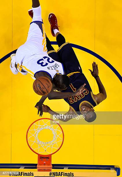 Draymond Green of the Golden State Warriors goes up against James Jones of the Cleveland Cavaliers in the first half during Game Five of the 2015 NBA...