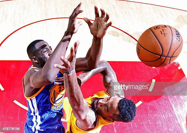 Draymond Green of the Golden State Warriors goes up against JR Smith of the Cleveland Cavaliers in the first half during Game Four of the 2015 NBA...