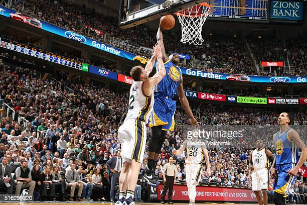 Draymond Green of the Golden State Warriors goes up for a dunk against the Utah Jazz on March 30 2016 at vivintSmartHome Arena in Salt Lake City Utah...