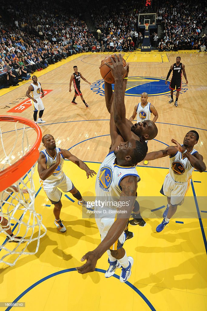 Draymond Green #23 of the Golden State Warriors goes up for a rebound against Joel Anthony #50 of the Miami Heat on January 16, 2013 at Oracle Arena in Oakland, California.