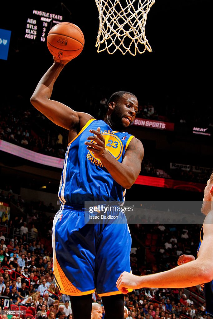 Draymond Green #23 of the Golden State Warriors grabs a rebound against the Miami Heat on December 12, 2012 at American Airlines Arena in Miami, Florida.