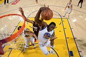 Draymond Green of the Golden State Warriors grabs a rebound against the Miami Heat on January 14 2015 at Oracle Arena in Oakland California NOTE TO...