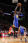 Draymond Green of the Golden State Warriors grabs the rebound against the Houston Rockets on December 31 2015 at the Toyota Center in Houston Texas...