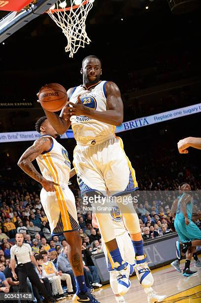 Draymond Green of the Golden State Warriors grabs the rebound against the Charlotte Hornets on January 4 2016 at Oracle Arena in Oakland California...