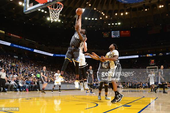 Draymond Green of the Golden State Warriors grabs the rebound against the Brooklyn Nets on February 25 2017 at ORACLE Arena in Oakland California...