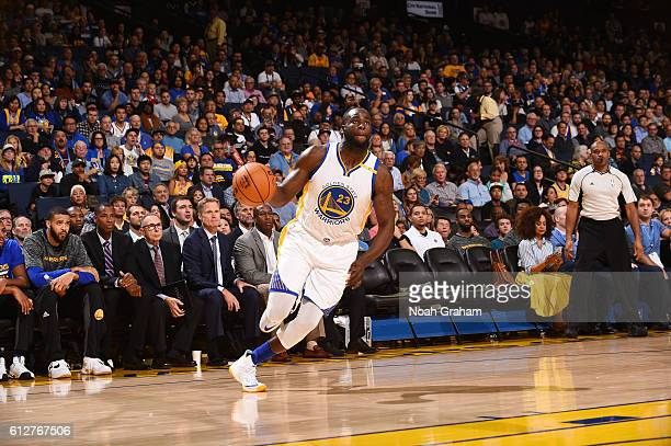 Draymond Green of the Golden State Warriors handles the ball against the Los Angeles Clippers during a preseason game on October 4 2016 at ORACLE...