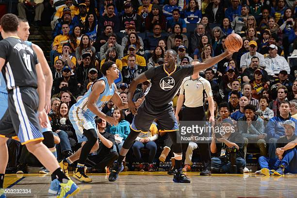 Draymond Green of the Golden State Warriors handles the ball during the game against the Denver Nuggets on January 2 2016 at ORACLE Arena in Oakland...
