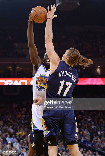 Draymond Green of the Golden State Warriors has his pass blocked by Lou Amundson of the New Orleans Pelicans at ORACLE Arena on December 17 2013 in...