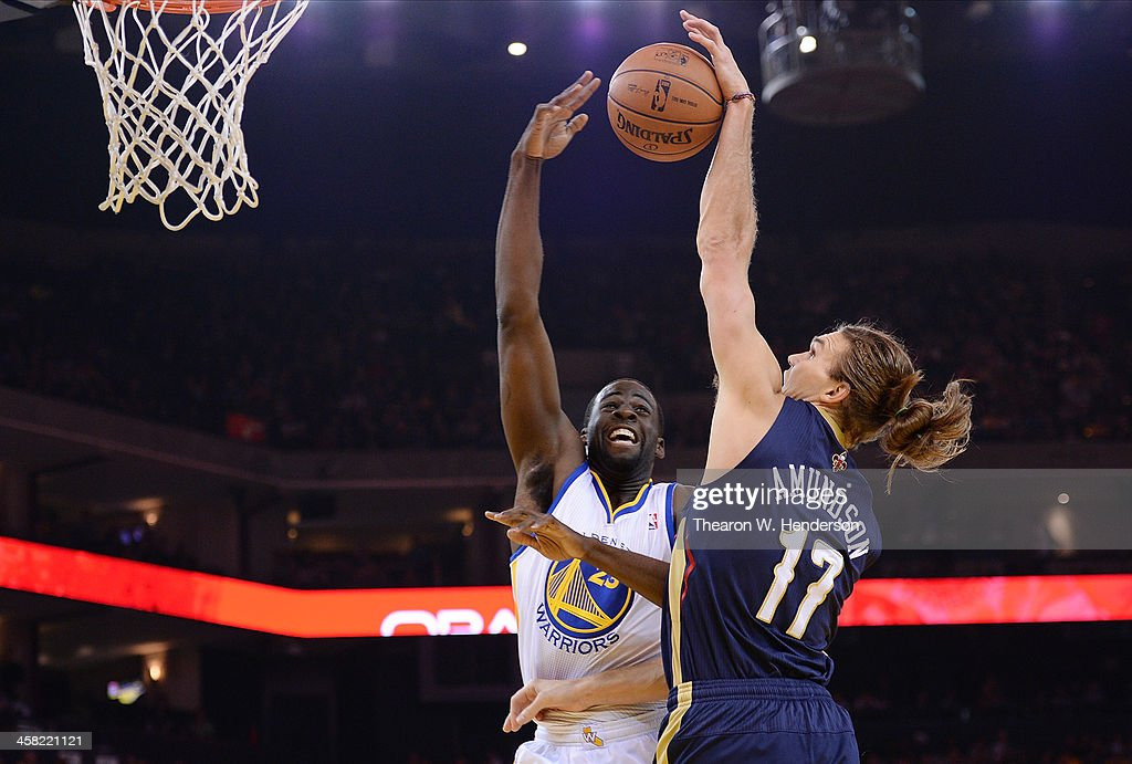 Draymond Green #23 of the Golden State Warriors has his pass blocked by Lou Amundson #17 of the New Orleans Pelicans at ORACLE Arena on December 17, 2013 in Oakland, California.