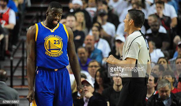 Draymond Green of the Golden State Warriors has some words with referee Scott Foster after he was called for a blocking foul during the first quarter...