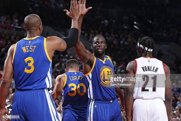 Draymond Green of the Golden State Warriors high fives David West during the game against the Portland Trail Blazers on November 1 2016 at the Moda...