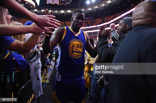 Draymond Green of the Golden State Warriors high fives fans after the game against the Boston Celtics on December 11 2015 at the TD Garden in Boston...