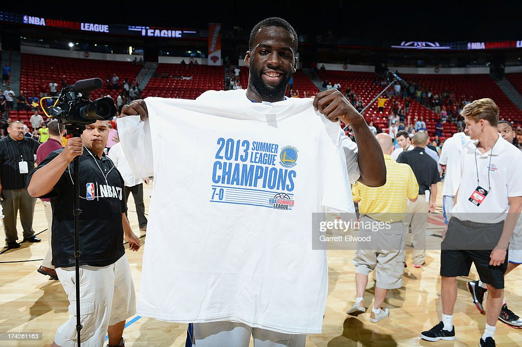 <a gi-track='captionPersonalityLinkClicked' href=/galleries/search?phrase=Draymond+Green&family=editorial&specificpeople=5628054 ng-click='$event.stopPropagation()'>Draymond Green</a> #23 of the Golden State Warriors holds up his championship tee-shirt afterr the game against the Phoenix Suns during NBA Summer League Championship Game on July 22, 2013 at the Cox Pavilion in Las Vegas, Nevada.