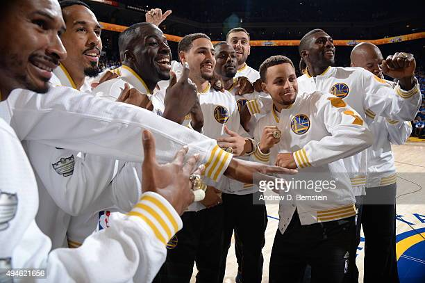 Draymond Green of the Golden State Warriors Klay Thompson of the Golden State Warriors and Stephen Curry of the Golden State Warriors show off their...