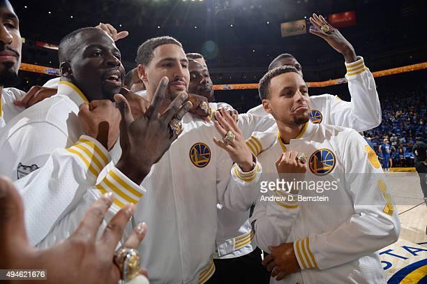 Draymond Green of the Golden State Warriors Klay Thompson of the Golden State Warriors and Stephen Curry of the Golden State Warriors show off their...
