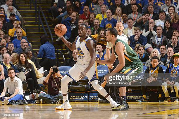 Draymond Green of the Golden State Warriors looks to pass against the Utah Jazz on December 20 2016 at ORACLE Arena in Oakland California NOTE TO...