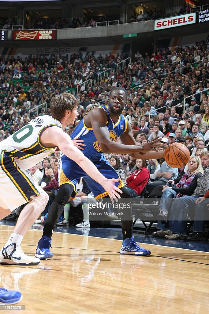 <a gi-track='captionPersonalityLinkClicked' href=/galleries/search?phrase=Draymond+Green&family=editorial&specificpeople=5628054 ng-click='$event.stopPropagation()'>Draymond Green</a> #23 of the Golden State Warriors looks to pass the ball against <a gi-track='captionPersonalityLinkClicked' href=/galleries/search?phrase=Gordon+Hayward&family=editorial&specificpeople=5767271 ng-click='$event.stopPropagation()'>Gordon Hayward</a> #20 of the Utah Jazz at Energy Solutions Arena on December 26, 2012 in Salt Lake City, Utah.