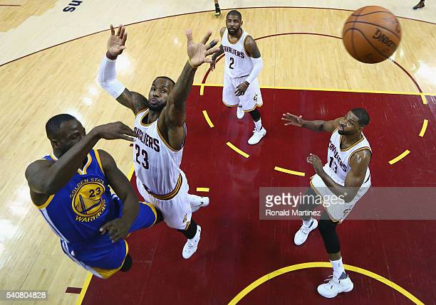 Draymond Green of the Golden State Warriors passes the ball against LeBron James of the Cleveland Cavaliers during the first half in Game 6 of the...