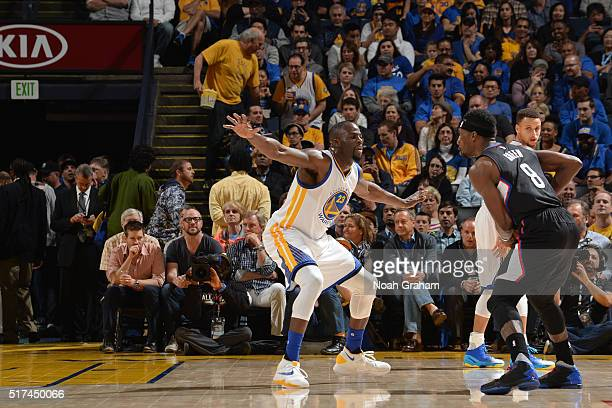 Draymond Green of the Golden State Warriors play defense against Jeff Green of the Los Angeles Clippers on March 23 2016 at Oracle Arena in Oakland...