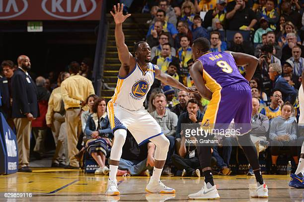 Draymond Green of the Golden State Warriors plays defense against Luol Deng of the Los Angeles Lakers during a game on November 23 2016 at Oracle...