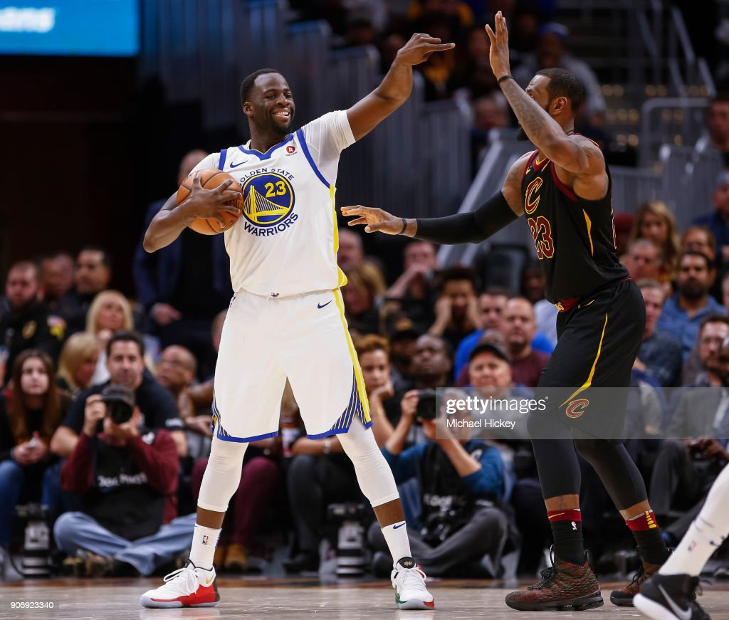 Draymond Green #23 of the Golden State Warriors points during the game against the Cleveland Cavaliers at Quicken Loans Arena on January 15, 2018 in Cleveland, Ohio.