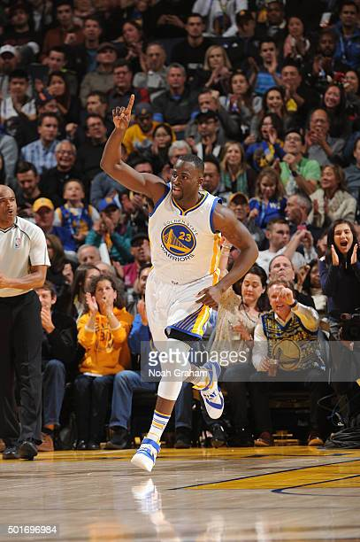Draymond Green of the Golden State Warriors points to the sky while facing the Phoenix Suns on December 16 2015 at Oracle Arena in Oakland California...