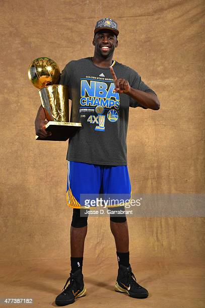Draymond Green of the Golden State Warriors poses for a portrait with the Larry O'Brien trophy after defeating the Cleveland Cavaliers in Game Six of...