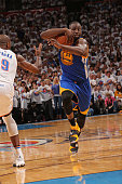 Draymond Green of the Golden State Warriors protects the ball as he drives to the basket against the Oklahoma City Thunder in Game Four of the...