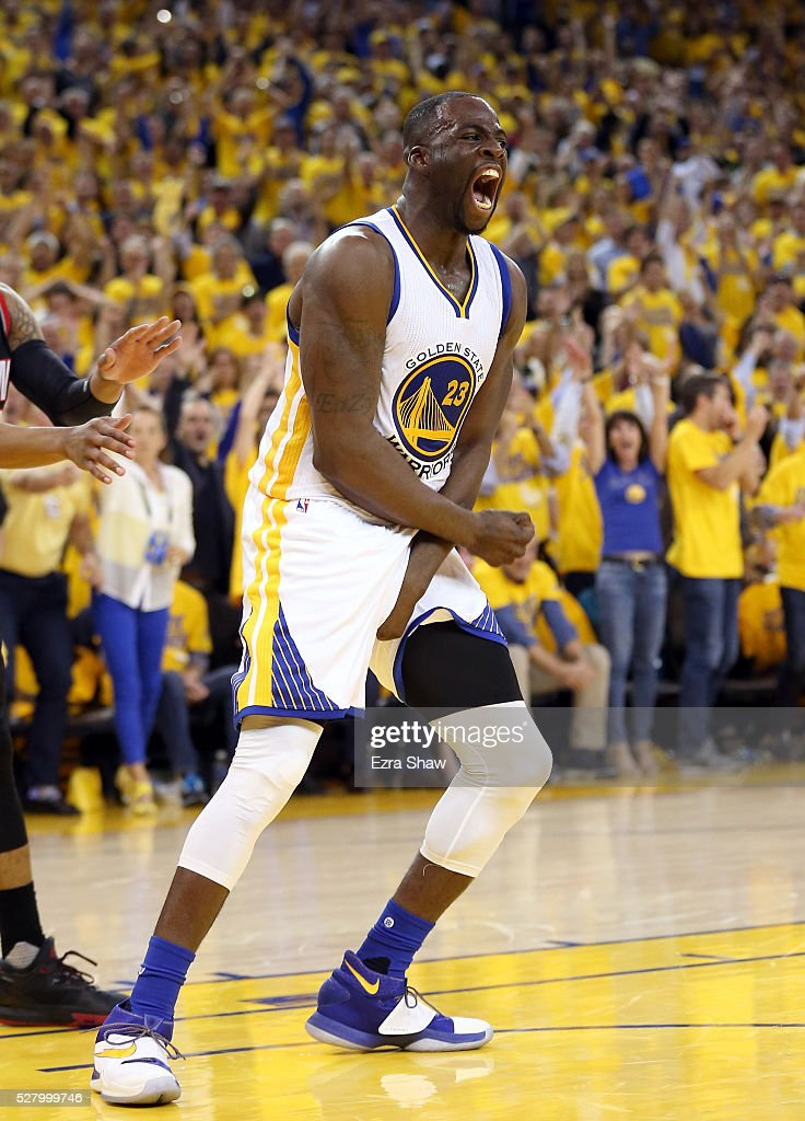 Draymond Green of the Golden State Warriors reacts after dunking the ball during their game against the Portland Trail Blazers in Game Two of the...