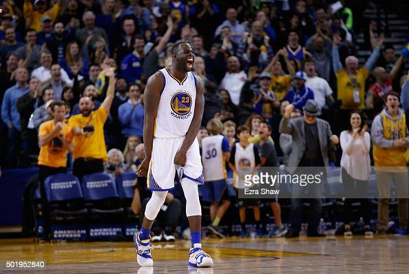 Draymond Green of the Golden State Warriors reacts after he made a threepoint basket against the Milwaukee Bucks at ORACLE Arena on December 18 2015...