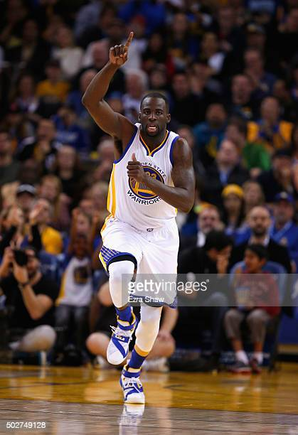 Draymond Green of the Golden State Warriors reacts after making a basket against the Sacramento Kings at ORACLE Arena on December 28 2015 in Oakland...