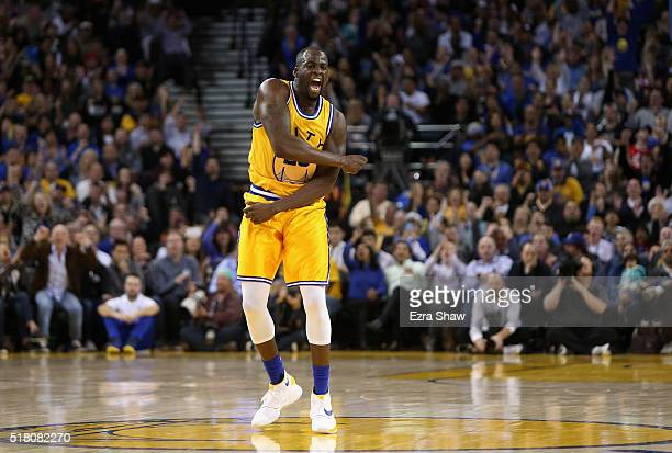 Draymond Green of the Golden State Warriors reacts after making a shot during their game against the Washington Wizards at ORACLE Arena on March 29...