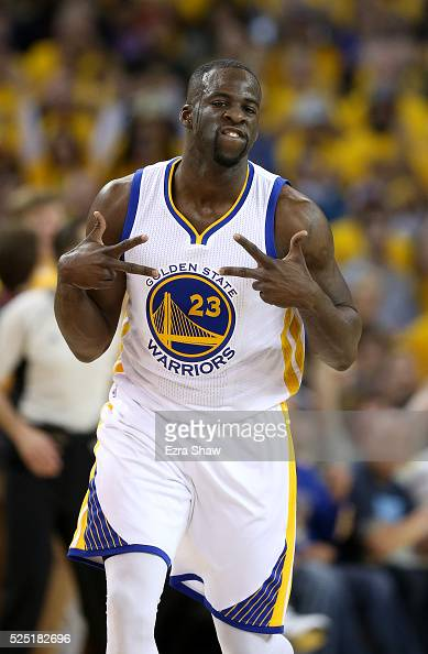 Draymond Green of the Golden State Warriors reacts after making a basket against the Houston Rockets in Game Five of the Western Conference...