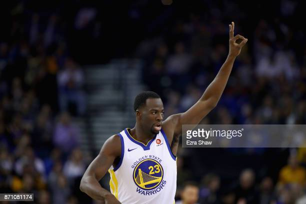 Draymond Green of the Golden State Warriors reacts after making a threepoint basket against the Miami Heat at ORACLE Arena on November 6 2017 in...