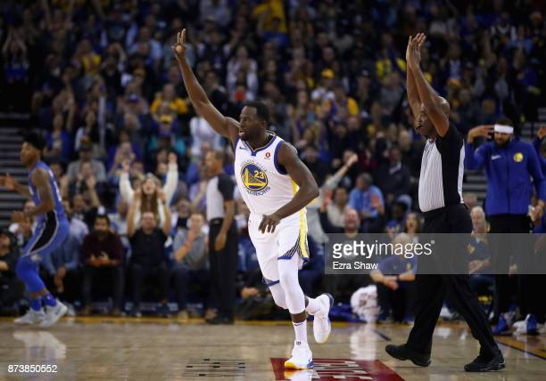 Draymond Green of the Golden State Warriors reacts after making a threepoint basket against the Orlando Magic at ORACLE Arena on November 13 2017 in...