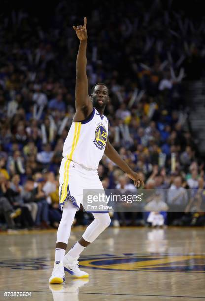 Draymond Green of the Golden State Warriors reacts after making a basket against the Orlando Magic at ORACLE Arena on November 13 2017 in Oakland...