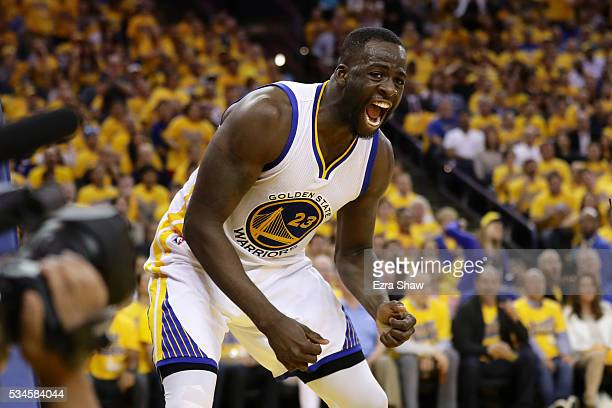 Draymond Green of the Golden State Warriors reacts after scoring against the Oklahoma City Thunder during Game Five of the Western Conference Finals...