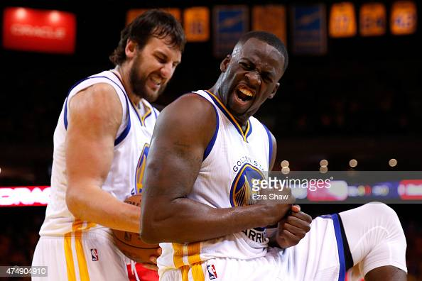 Draymond Green of the Golden State Warriors reacts alongside teammate Andrew Bogut in the second half against the Houston Rockets during game five of...