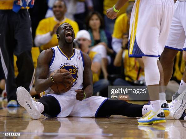 Draymond Green of the Golden State Warriors reacts at the end of the third period of their game against the Denver Nuggets during Game Three of the...